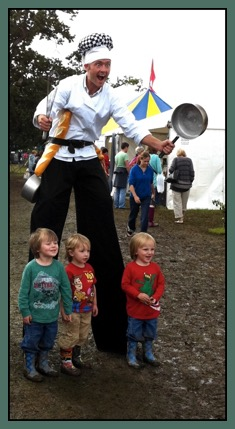A stiltwalking chef, showing off his circus skills alongside our Circus tent