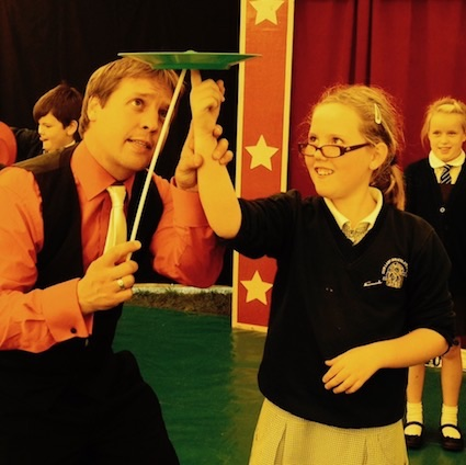 Circus Sensible performer teaching circus skills in a school