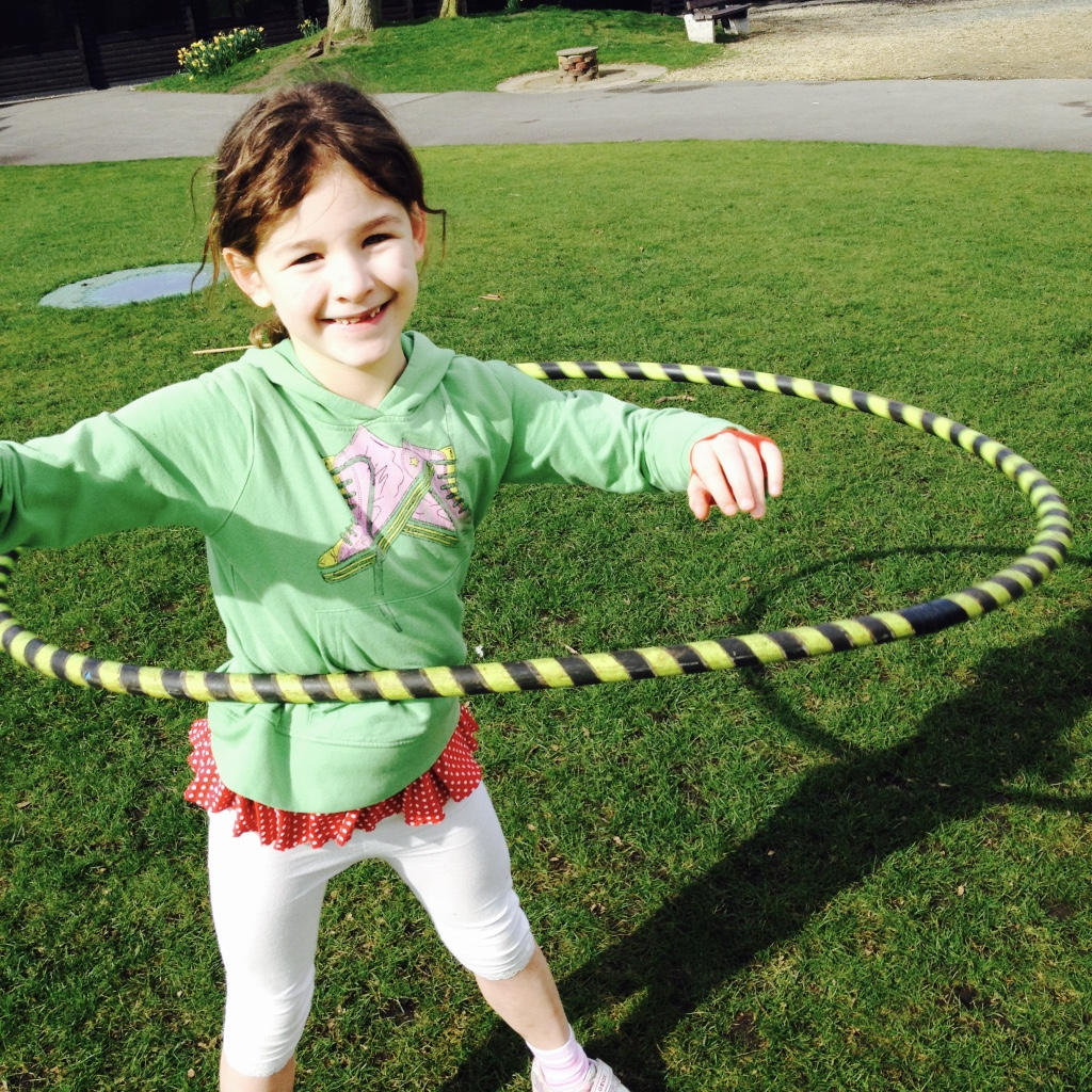 Learning to Hula Hoop at a School Fair